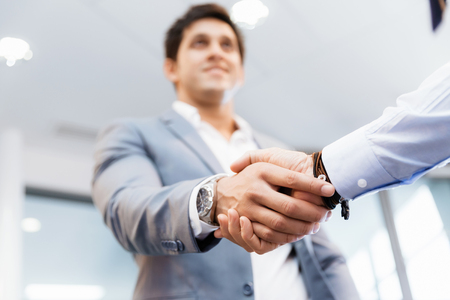 business relationship: Handshake of businessmen greeting each other