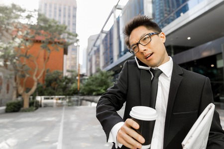 busy person: Businessman outdoors in city business district