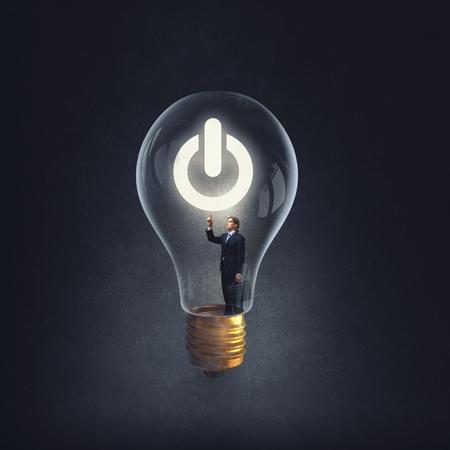 man holding luminous idea inside light bulb stock photo picture and