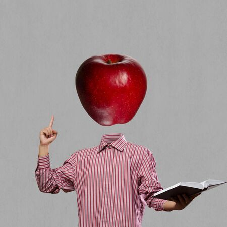 instead: Businessman with book in hand and apple instead of head