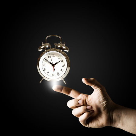 classical mechanics: Close up of man hand pointing at clock watch