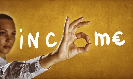 financial concept: Income word and businesswoman showing with fingers letter o