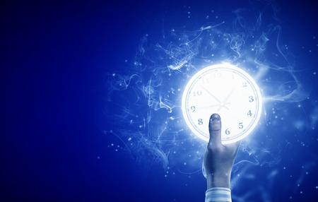 クローズの目覚まし時計で人間の手のイメージ アップ 写真素材