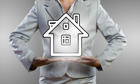 holding close: Close up of businesswoman holding in hands house model Stock Photo