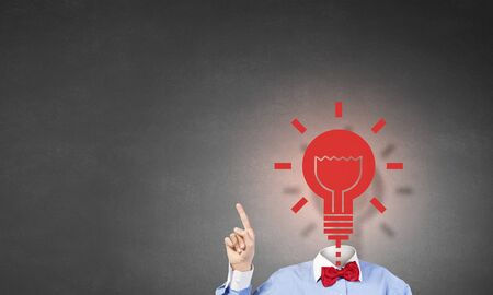 finger bow: Unrecognizable man in bow tie with light bulb instead of head Stock Photo