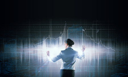 engineering and technology: Back view of businesswoman working with virtual panel