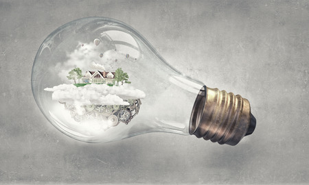 light house: Eco house and energy saving concept in glass light bulb