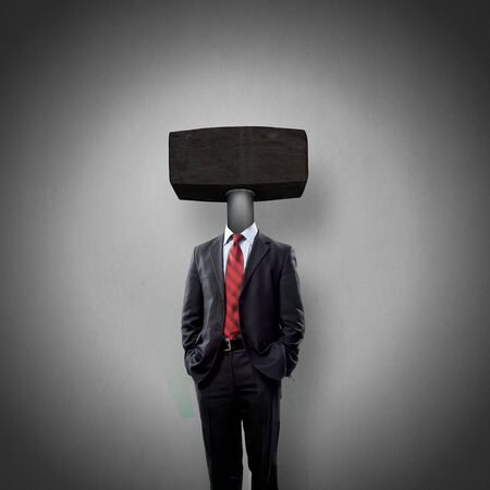 witty: Headless businessman with hamer instead of head