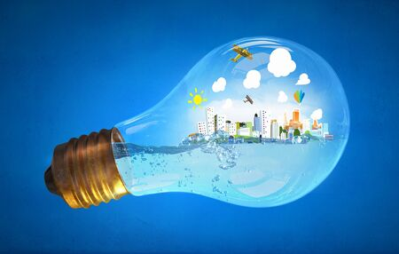 energy save: Glass light bulb with water and cityscape inside