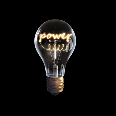 Glowing glass light bulb with power word inside Reklamní fotografie