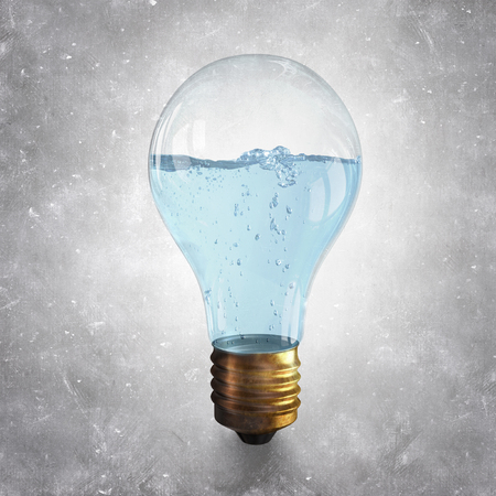 ecological problem: Glass light bulb with clear blue water inside Stock Photo