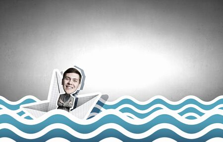 escapes: Businessman escapes from the crisis on paper boat