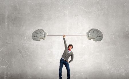 inspiration determination: Confident businessman lifting above head barbell as symbol of great mind