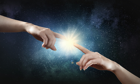 helping hand: Close up of human hands reaching each other with fingers
