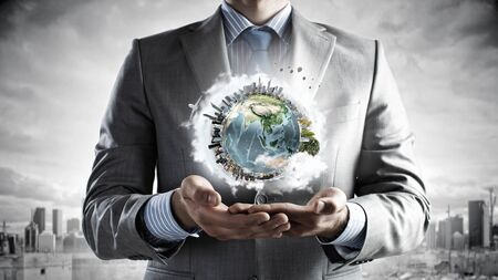 protection concept: Businessman hands holding Earth planet.