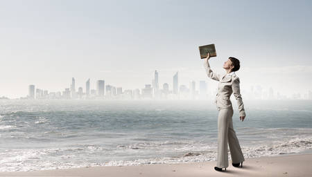 develope: Adult woman in suit with old book in hand