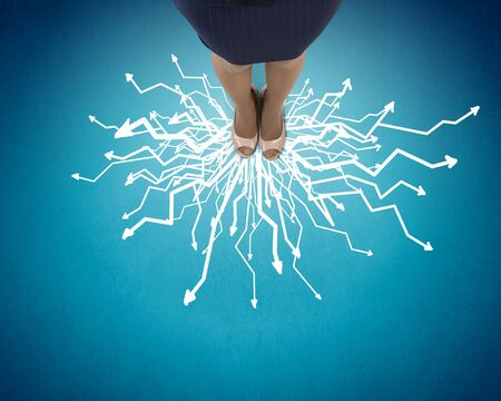 confused: Top view of businesswoman feet standing at crossroads Stock Photo