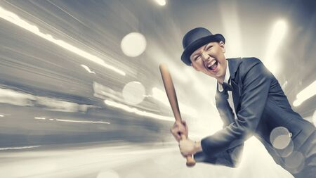 emotional woman: Young emotional woman in suit and hat with baseball bat