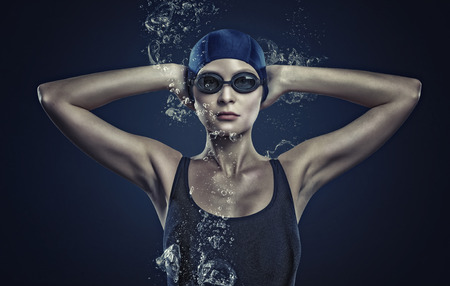 swimmer: Portrait of woman swimmer in cap and glasses Stock Photo