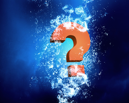 faq: Question mark sink in clear blue water Stock Photo