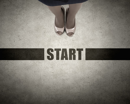 directive: Top view of businesswoman feet standing at start line