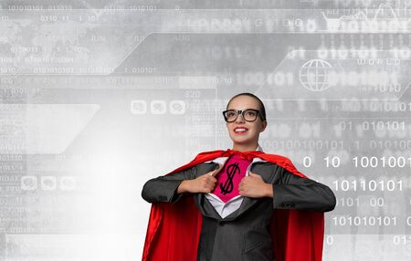 super hero: Young woman acting like super hero with dollar sign on chest