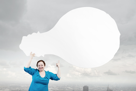 oversize: Stout woman of middle age with blank white idea banner Stock Photo