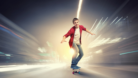boy skater: Handsome teenager cool acive boy riding skateboard