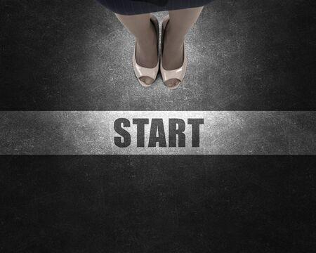 start line: Top view of businesswoman feet standing at start line