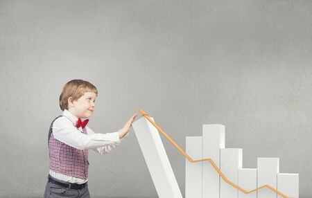 business chart: Little boy businessman and growing bar graph Stock Photo
