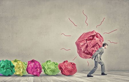 crumpled paper: Businessman carrying with effort big crumpled ball of paper as creativity sign Stock Photo