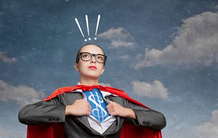 moneymaking: Young woman acting like super hero with dollar sign on chest