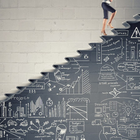 career young: Businesswoman climbing up staircase as symbol of career rise Stock Photo