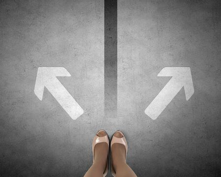 directive: Top view of businesswoman feet standing at crossroads Stock Photo