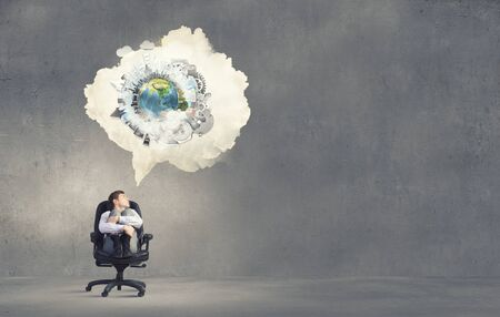 thought cloud: Businessman in chair and blank thought cloud above his head.  Stock Photo