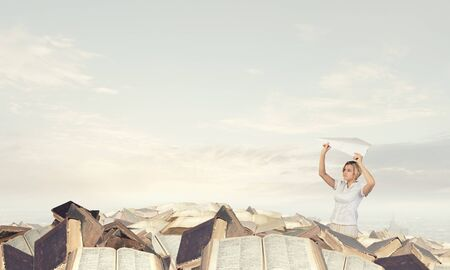 carefree: Young carefree woman with paper plane in hands Stock Photo