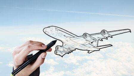 model airplane: Person drawing airplane model on sky background