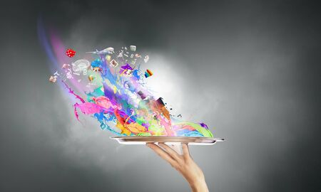 add: Hand hold silver tray with colored paint splashes