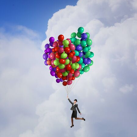 bowler: Businesswoman in suit and bowler hat flying on balloon