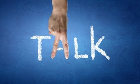 written communication: Talk word with fingers instead of letter A Stock Photo