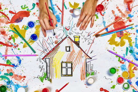 Top view of hands drawing house colorful concept
