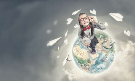 wideangle: Wideangle picture of funny schoolgirl with paper plane.  Stock Photo