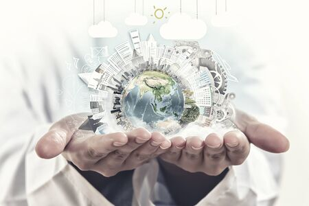 protection hands: Male hands holding world concept in palms. Elements of this image are furnished by NASA Stock Photo