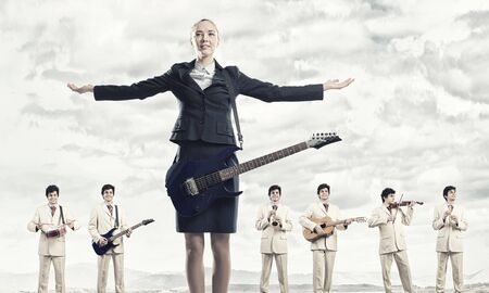 business performance: Man orchestra playing different music instruments and woman leader
