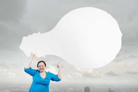 stout: Stout woman of middle age with blank white idea banner Stock Photo