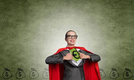 moneymaking: Young woman acting like super hero with euro sign on chest