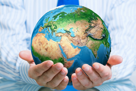 planets: Businessman hands holding Earth planet. Elements of this image are furnished by NASA