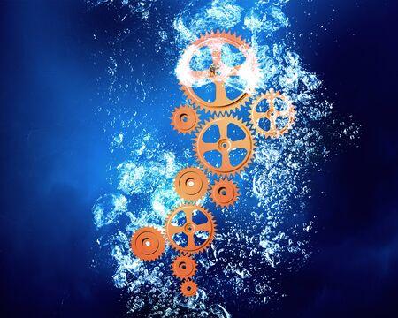 clear: Gears sinking in clear blue crystal water