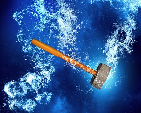 hammers: Hammer instrument sinking in clear blue water