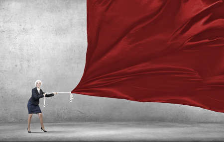 santa suit: Woman in Santa suit pulling red clothing banner Stock Photo